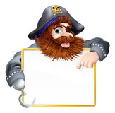 Happy pirate pointing at sign. A happy pirate pointing at sign with a gold border or frame Royalty Free Stock Images