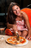 Happy with the pizza Stock Images