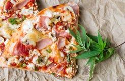 Happy pizza with marijuana leaves stock photo