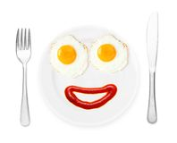 Happy plate with fried eggs. Stock Images