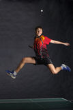 Happy player in long jumping Stock Image