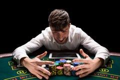 Happy player online poker Stock Photos