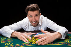 Happy player online poker Stock Photo