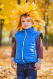 Happy playful boy have fun in the yellow leaves Stock Image