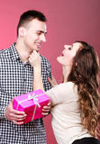 Happy playful couple with gift box Stock Photos