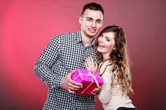 Happy playful couple with gift box Royalty Free Stock Image