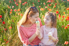 Happy Playful family, mother and daughter. Happy Playful family. Young beautiful  mother and her daughter having fun, and Eat ice cream. Positive human emotions Royalty Free Stock Images