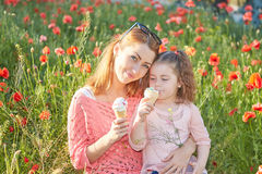Happy Playful family, mother and daughter. Happy Playful family. Young beautiful  mother and her daughter having fun, and Eat ice cream. Positive human emotions Royalty Free Stock Photos