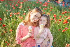 Happy Playful family, mother and daughter. Happy Playful family. Young beautiful  mother and her daughter having fun, and Eat ice cream. Positive human emotions Stock Images