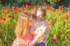 Happy Playful family, mother and daughter. Happy Playful family. Young beautiful  mother and her daughter having fun, and Eat ice cream. Positive human emotions Stock Photo