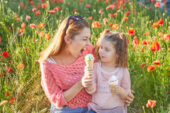 Happy Playful family, mother and daughter. Happy Playful family. Young beautiful  mother and her daughter having fun, and Eat ice cream. Positive human emotions Royalty Free Stock Photography