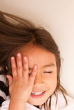 Happy, playful little girl Royalty Free Stock Photo