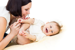 Happy playful mother and her baby boy infant Stock Photos