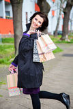 Happy playful woman after great shopping Royalty Free Stock Photos