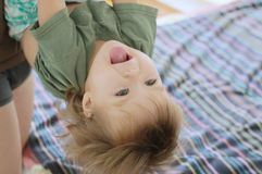 Happy playing child with daddy standing upside down Royalty Free Stock Photo