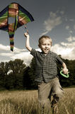 Happy playing child with kite Stock Photography