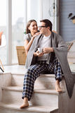Happy pleasant couple sitting on the stairs Royalty Free Stock Photos