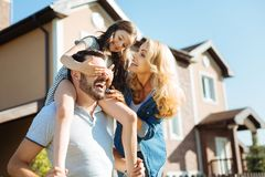 Happy pleasant family having fun together in the backyard Royalty Free Stock Image