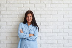 Happy pleased woman smiling with arms crossed Stock Photo