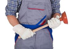 Happy plumber holding plunger Royalty Free Stock Image