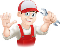 Happy plumber or mechanic with spanner Stock Photo