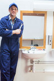 Happy plumber posing with wrench Royalty Free Stock Image