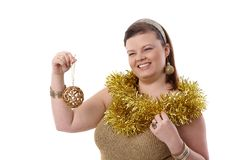 Happy plump woman at christmas time Stock Photos