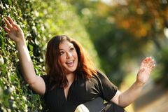 Happy plus size girl. Happy plus size woman outdoors. Shallow DOF stock photos