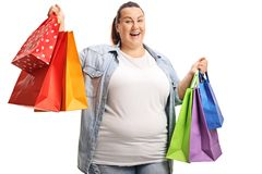 Happy plus size woman holding shopping bags royalty free stock photo