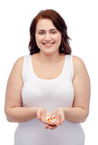 Happy plus size woman in underwear with pills Stock Photos