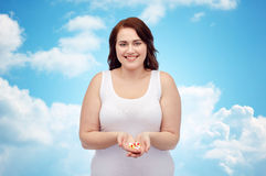 Happy plus size woman in underwear with pills Royalty Free Stock Images
