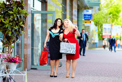 Happy plus size women shopping Stock Photos