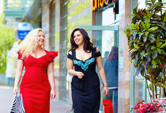 Happy plus size women shopping. Two happy plus size women shopping royalty free stock image