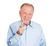 Happy pointing older man Royalty Free Stock Photos