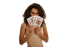 Happy with a Poker. A pretty young lady hiding her face happy with a Poker stock images