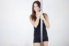 Happy pole dancer Stock Photos