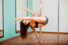 Happy pole dancer trying a routine Royalty Free Stock Photo