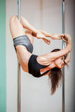 Happy pole fitness student royalty free stock photography