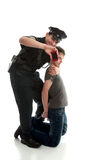 Happy policeman with apprehended teen boy Stock Photo