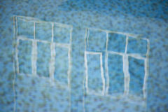 Happy pool reflection that makes you feel good and dreamy. From this perspective the aqua pool reflection of windows mirrors off t Stock Photo