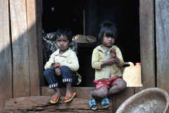 Happy poor cute children in asia tropical village. Poor children boy and girl along mekong river in village, taken in Cambodia east, asia royalty free stock photo