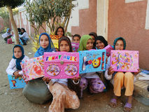 Happy poor muslim girls in veil received presents and gifts in Egypt Stock Image
