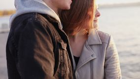 Happy portrait of couple in love stands in embraces at the evening lake stock video