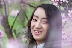 Happy Portrait of Smiling Vietnamese girl in White Ao Dai Stock Photo