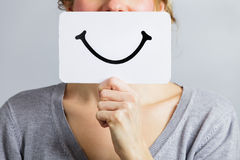 Happy Portrait of Someone Holding a Smiling Mood Board Stock Photo