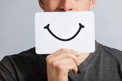 Happy Portrait of Someone Holding a Smiling Mood Board Stock Photography