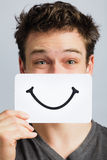 Happy Portrait of Someone Holding a Smiling Mood Board Royalty Free Stock Photos