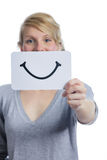 Happy Portrait of Someone Holding a Smiling Mood Board. Happy Portrait of a Woman Holding a Smiling Mood Board Isolated on White Background royalty free stock photo