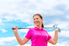 Happy portrait of a woman golfer with golf club Royalty Free Stock Photos