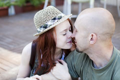 Happy Portrait of Young kissing couple Stock Photo